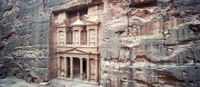 Ancient Treasury In Petra Jordan Seen From The Siq. View From The Top. Main Attraction Of The Lost City Of Petra In Jordan. The Temple Is Entirely Carved Into The Rock. Ancient Architecture.