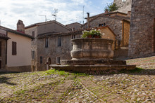 A Travertine Well In The Centr...
