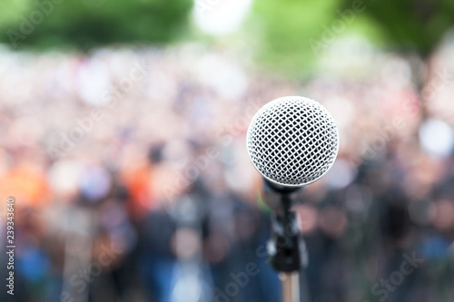 Photo Microphone in focus against blurred protest or public demonstration