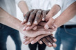 Leinwanddruck Bild - Business team joining hands together