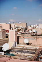 Satellite Dishes On City Rooft...