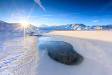 Rays Of Sun On The Frozen Lake Piz Umbrail Framed By Mount Ortles In Background Braulio Valley Valtellina Lombardy Italy Europe