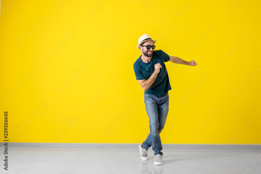 Fototapety, obrazy: Handsome young man dancing near color wall