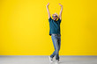 canvas print picture - Handsome young man dancing near color wall