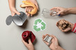 Leinwanddruck Bild - Hands with garbage and recycling symbol on light background