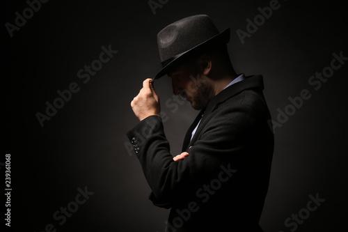 Fototapeta Portrait of detective on dark background