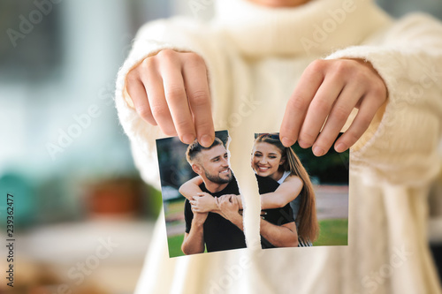 Woman tearing up photo of happy couple, closeup Canvas Print