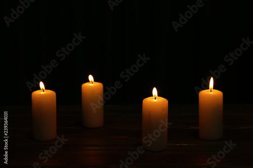 Fototapeta Burning candles on dark background obraz na płótnie
