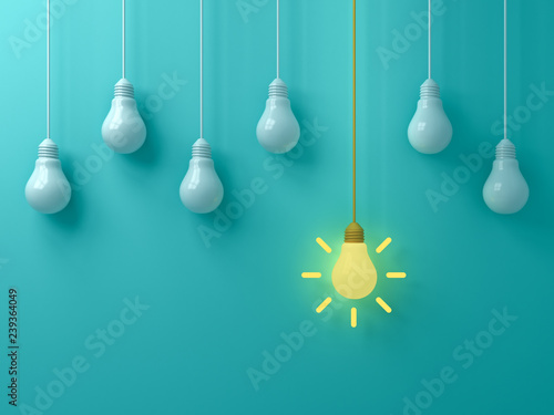 Photo  Think different concept One hanging yellow idea light bulb standing out from whi