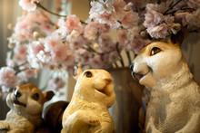 Three Squirrel Dolls On A Table.