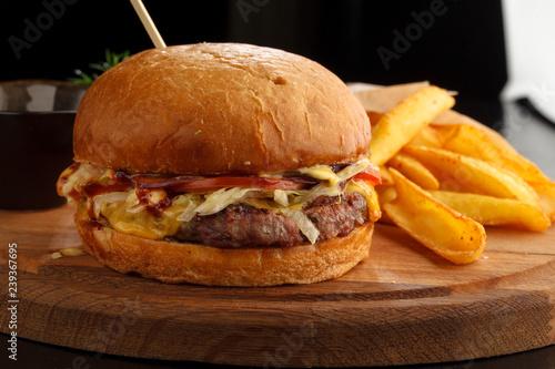 Big tasty burger and fries on the table © Назим Теймуров