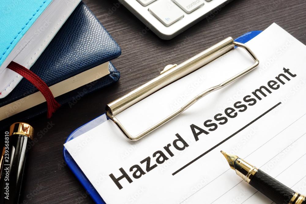 Fototapeta Hazard assessment form with clipboard on a desk.