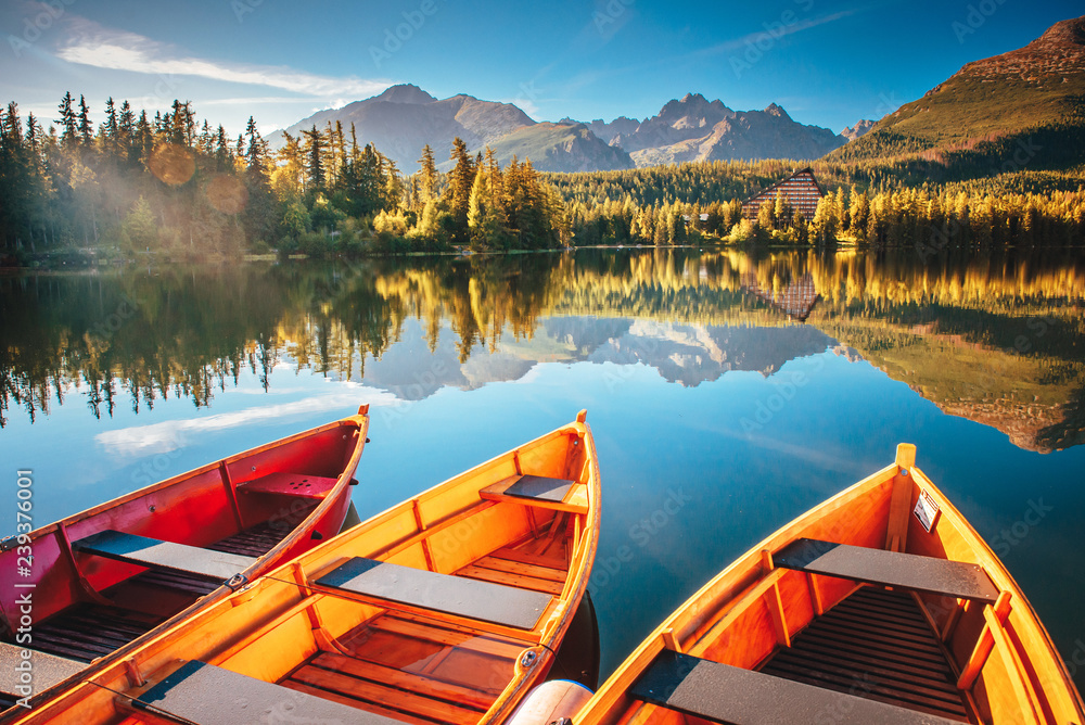 Fototapety, obrazy: Morning lake Strbske pleso in Tatra mountains. Colorful boats on the water