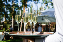 Glasses With Champagne At A Wedding Outdor