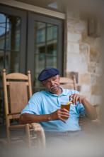 Senior Man Sitting In A Wicker...