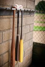 Three Baseball Bats Hanging Fr...