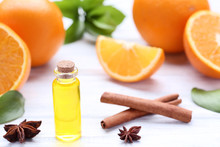 Orange Oil In Bottle With Star Anise And Cinnamon On Wooden Table