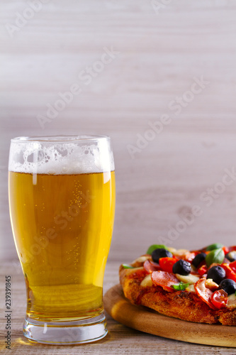 Foto op Canvas Bier / Cider Glass of beer and pizza on wooden table. Beer and food concept. Ale. Copy space