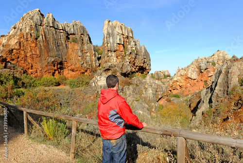 Photo  A teenboy hiking in Cerro del Hierro (Iron Hill), eroded landscape of old abando