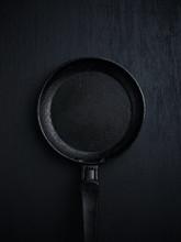 Frying Pan On Black Background