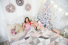 Cute Little Child Girl With Xmas Present. Happy Little Girl Celebrate Winter Holiday. Christmas Time. Morning Before Xmas. Happy New Year. Delivery Christmas Gifts. Holiday At Home. Decor