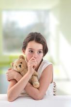 Teen Girl Lovingly Holding A T...