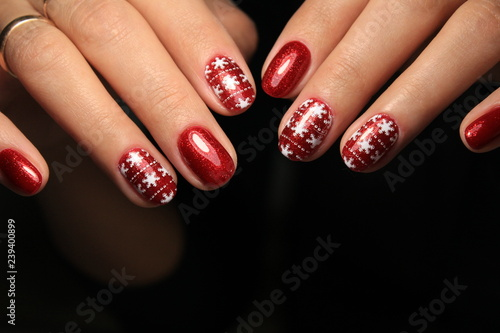 Fototapeta Christmas manicure on artificial nails
