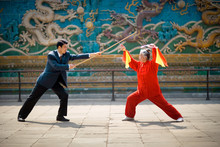 Mid-adult Businessman And A Senior Woman Performing Traditional Martial Arts.