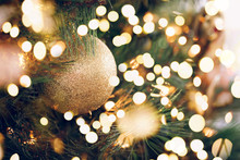 Seasonal Background With Christmas Toy On The Tree. Celebration Concept. Soft Focus. Festive Bold Bokeh