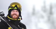 Portrait Of A Happy Male Skier