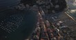 Aerial shot of Town Sestri Levante being lit by last sun rays on warm sunny afternoon, Italy