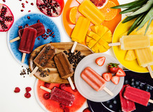Colorful Assorted Popsicles With Fruit And Ingredients