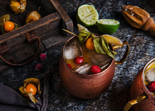 Moscow Mule With Cranberry And Gooseberry Garnish