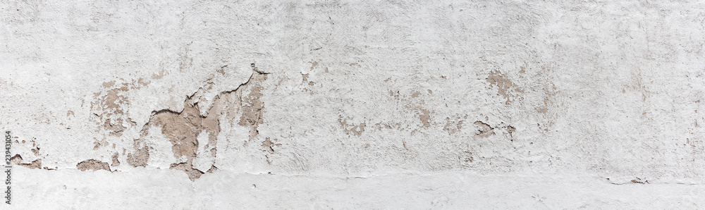 Fototapeta Ancient wall with peeling plaster. Old concrete wall, panoramic textured background