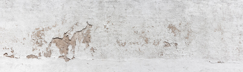Ancient wall with peeling plaster. Old concrete wall, panoramic textured background