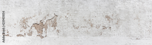 fototapeta na szkło Ancient wall with peeling plaster. Old concrete wall, panoramic textured background