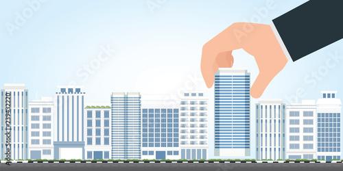 Valokuva  Businessman select to holding modern building.