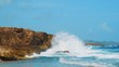 Waves crashing and spraying coral boulders on Curacao coast, Slow Motion