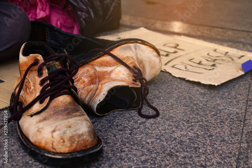 """Fotografie, Obraz  Label """"Help please"""" word with dollar , hat and Old shoes for homeless"""