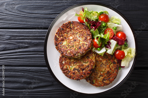 Delicious mushroom vegetable patties served with fresh salad on a plate close-up. horizontal top view