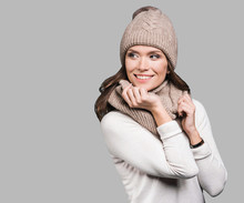 Beautiful Woman Looking Away. Isolated On Grey Background. Smiling Girl Wearing Warm Clothes, Winter Portrait