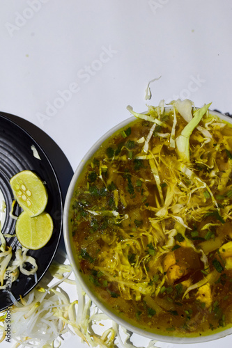 soto ayam traditional food of surabaya indonesia with bean sprouts lime and messy noodles culinary concept with a white background buy this stock photo and explore similar images at adobe stock adobe stock