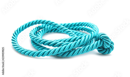Fotografiet  Rolled rope on white background