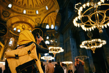 Woman In Hagia Sophia Cathedral Taking Photos On Phone