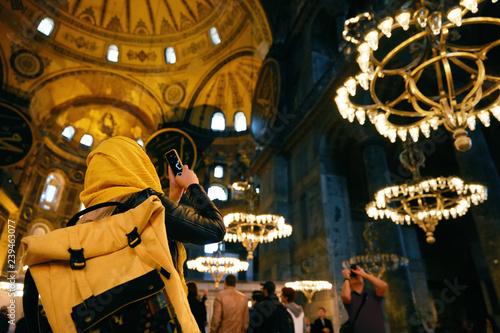 Fotografía Woman In Hagia Sophia Cathedral Taking Photos On Phone
