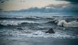 waves breaking on rocks in the sea