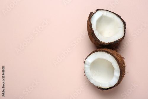 Fotografia Cut ripe coconut on color background