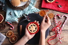 Woman With Tasty Mince Pies At Table
