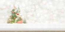 White Marble Table Top At Blur Bokeh Christmas Tree Decor With String Light Background When Show Falling,Winter Holiday Greeting Card
