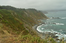 Green Cliffs With Sea Waves Br...